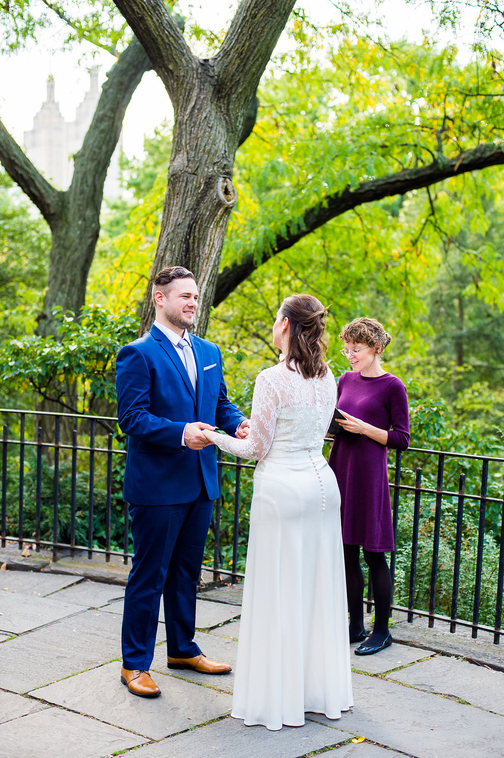 Wedding Officiant marries couple on the balcony by the Shakespeare Garden in Central Park.